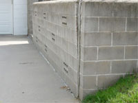 A retaining wall separating from the adjoining walls in York, Yarmouth, South Berwick, Brunswick, and Lewiston