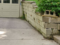 a failing retaining wall around a driveway in Portland