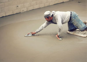 smoothing out the grout in a slab releveling project in Waterville