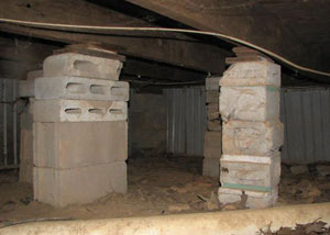 crawl space repairs done with concrete cinder blocks and wood shims in a Windham home