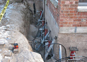 Foundation push piers installed around a house with a foundation settlement issues in Skowhegan
