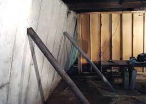 A severely tilting foundation wall propped up by steel beams in York, Yarmouth, South Berwick, Brunswick, and Lewiston.