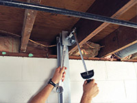 Straightening a foundation wall with the PowerBrace™ i-beam system in a Biddeford home.