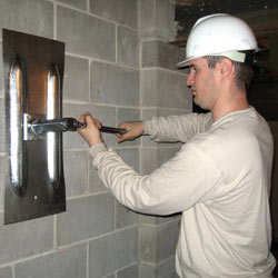 installing a wall anchor to repair an bowing foundation wall in Biddeford