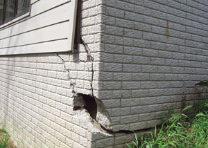 A severely damaged foundation wall in Auburn