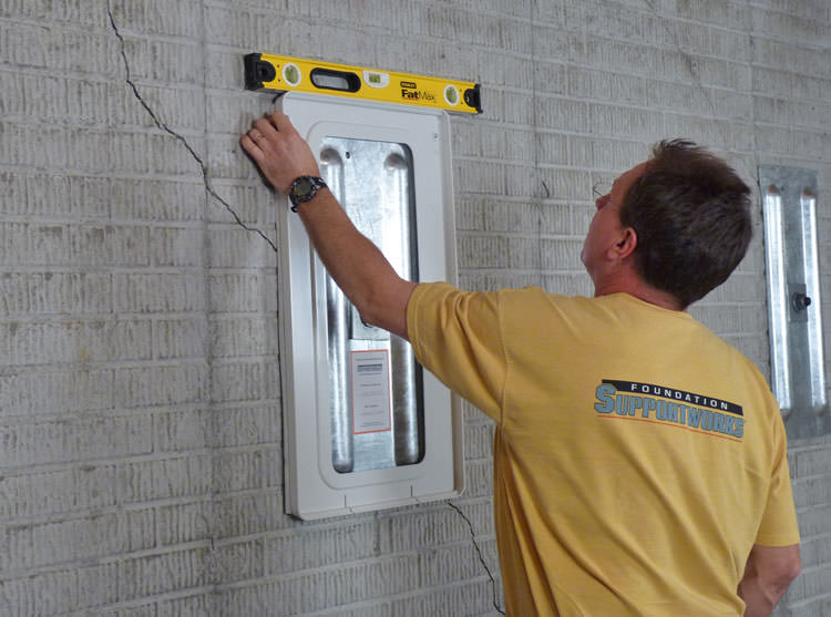 positioning a wall plate cover on a foundation wall in augusta