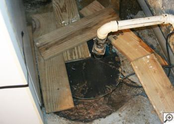 An ugly, clogged sump pump system in Augusta, Maine and New Hampshire