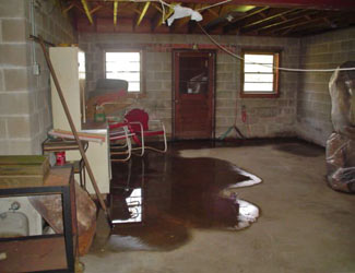 a flooded basement floor in a Falmouth home