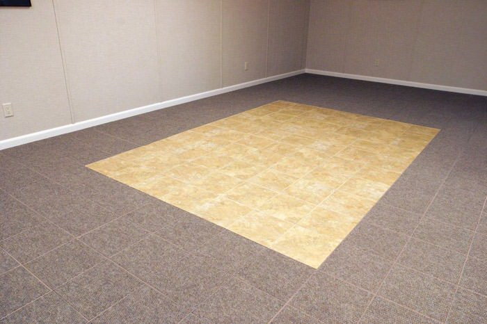 tiled and carpeted basement flooring installed in a Lewiston home