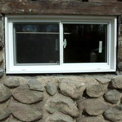 An energy efficient double-paned window installed in a basement in Scarborough.