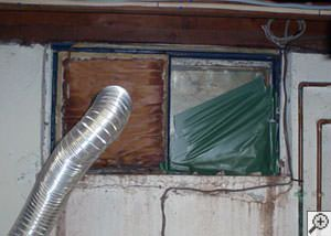 A basement window system that's rotted and  has been damaged over time in Windham.