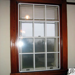 Advanced Energy window panels installed on a basement window system in Saco.