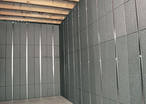 SilverGlo™ insulation and metal studs making up our Basement to Beautiful panels.  Installed in Dover.